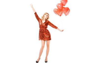 Beautiful woman in red dress with balloons isolated on white