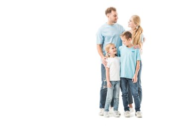Happy family standing in jeans and smiling isolated on white stock vector