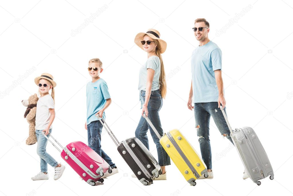 Happy family walking with colourful luggage and smiling isolated on white stock vector