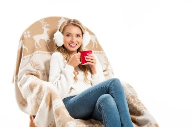 Happy young woman holding cup on coffee while sitting in rocking chair isolated on white stock vector