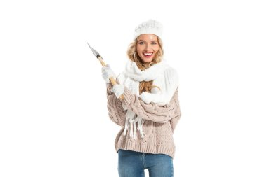 attractive smiling woman holding axe isolated on white