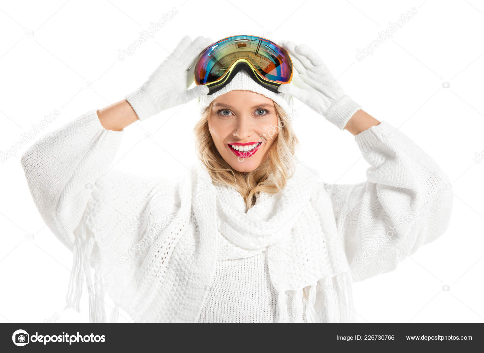 Beautiful young woman in winter clothes with ski goggles on head smiling  and looking at camera isolated on white– stock image 439c0eb7c