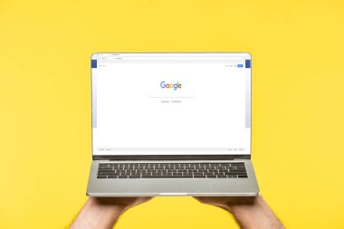 Cropped shot of person holding laptop with google website on screen isolated on yellow stock vector
