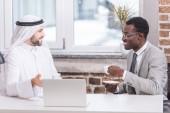 Fotografie Multiethnic businessmen having discussion in modern office