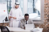 African american businessman using digital device in modern office