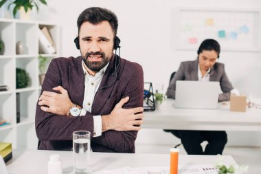call center operator freezing in cold office