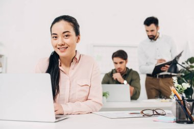 Selective focus of female manager sitting in modern office