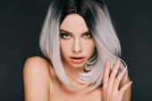 Fotografie beautiful naked girl posing in grey wig, isolated on black