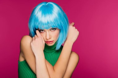 beautiful model with blue hair, isolated on pink