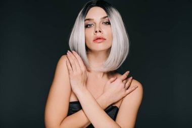 Beautiful glamor girl posing in grey wig, isolated on black stock vector