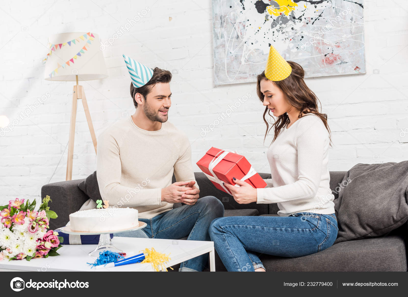 Couple Celebrating Birthday Man Presenting Birthday Gift Box