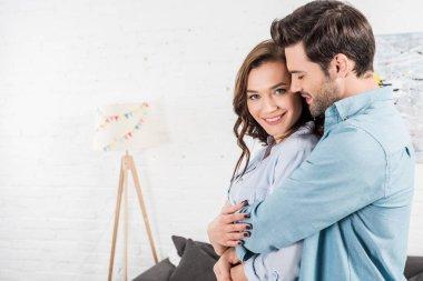 Man embracing beautiful smiling woman at home stock vector