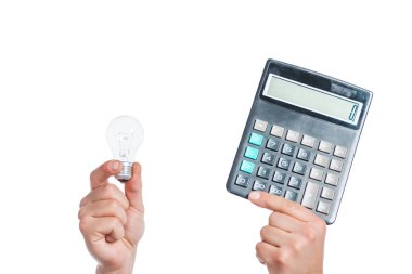 cropped view of male hands holding led lamp and calculator in hands isolated on white, energy efficiency concept