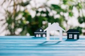 selective focus of paper houses on wooden desk, mortgage concept