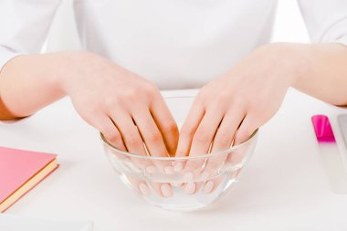Partial view of woman holding fingers in hand bath