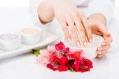 Photo Partial view of woman with perfect manicure doing hand treatment