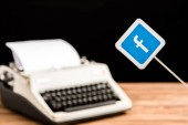 selective focus of facebook website icon with typewriter on background