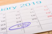 selective focus of calendar with marked number 31 and pay day lettering