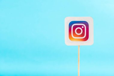 top view of instagram logo solated on blue with copy space