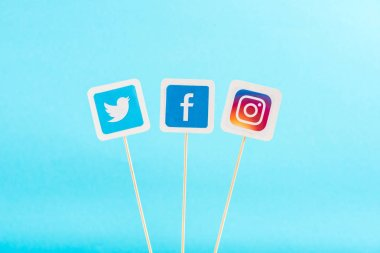 top view of twitter, facebook and instagram icons isolated on blue