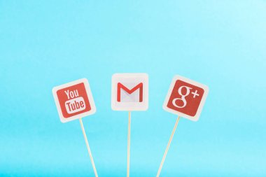 top view of google plus, gmail and youtube icons isolated on blue