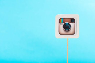 top view of instagram icon isolated on blue with copy space