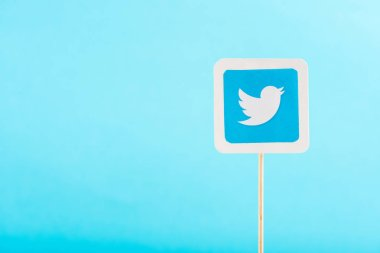 top view of twitter icon isolated on blue with copy space