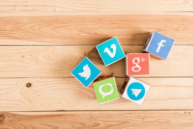 top view of website and app icons on wooden background