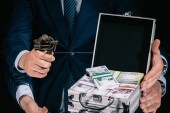cropped shot of businessman holding iron vise tool with russian ruble coin and suitcase safe box with banknotes