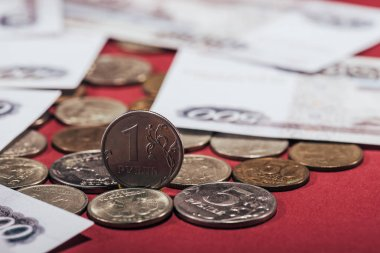 close-up view of russian rubles coins and banknotes on red, selective focus