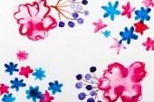 Fotografie top view of pink, blue and purple watercolor flowers with copy space