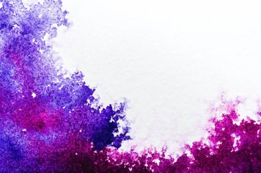 top view of purple and pink watercolor spills on white background