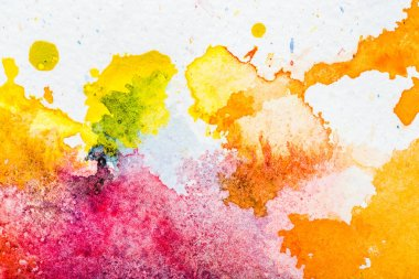 Top view of yellow, orange and pink watercolor spills on white paper stock vector