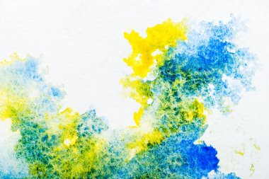 Top view of blue and yellow watercolor spills on white background stock vector