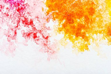 Top view of red and orange watercolor spills on white background stock vector