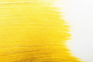 top view of yellow watercolor brushstrokes with on white background