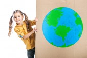 Fotografie cute child holding cardboard placard with globe sign isolated on white, earth day concept