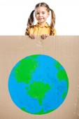 Fotografie adorable kid holding placard with globe sign, isolated on white, earth day concept