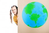 Fotografie cute kid holding cardboard placard with globe sign isolated on white, earth day concept