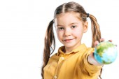 selective focus of adorable kid holding globe model in stretched hand isolated on white, earth day concept