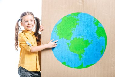 Smiling kid pointing at globe sign on cardboard placard isolated on white, earth day concept stock vector