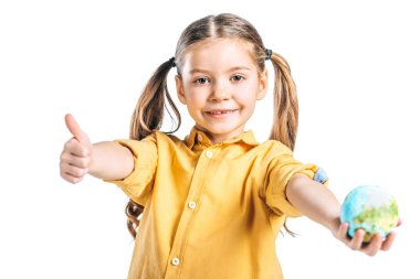 smiling kid holding globe model and showing thumb up isolated on white, earth day concept