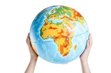 Partial view of child holding globe in raised hands isolated on white, earth day concept stock vector