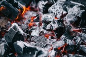 selective focus of hot burning coals in white ash