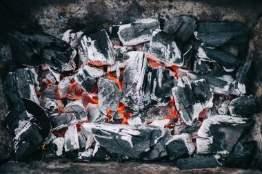 top view of hot burning coals with ash in fireplace