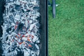 Fotografie top view of barbecue with burning hot coals and ash