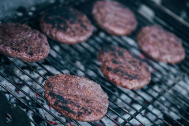 Selective focus of grilled fresh burger cutlets on bbq grid stock vector