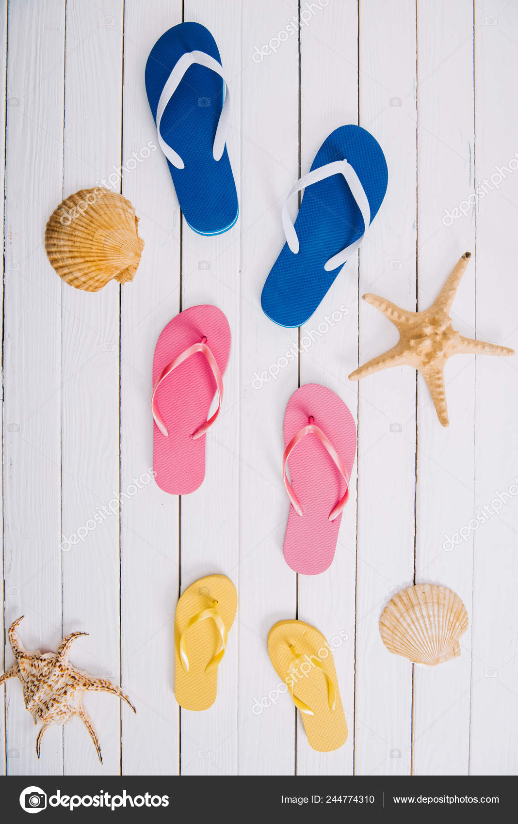 3e2b0a5d1 Top View Yellow Blue Pink Flip Flops White Wooden Background — Stock Photo