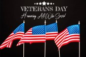 american flags with veterans day lettering isolated on black