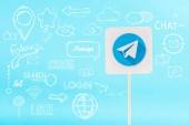 card with telegram logo and social media icons isolated on blue